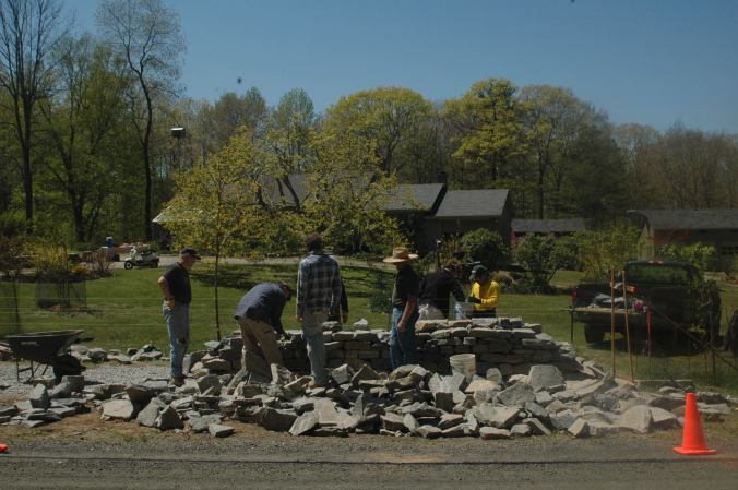 students learn how to build a dry stone wall