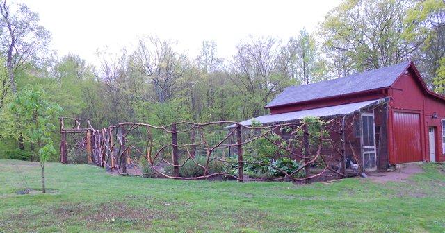 rustic garden fence built out of cedar